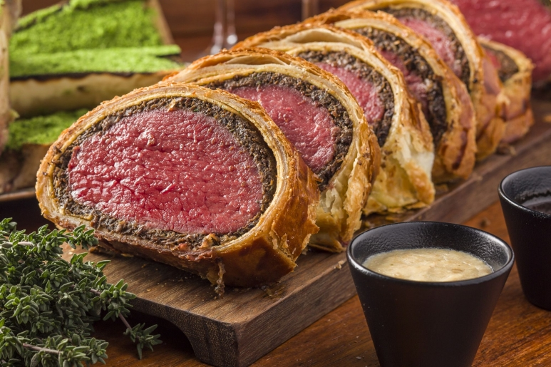 Classic British dishes such as beef Wellington are signatures at Maze Grill.jpg